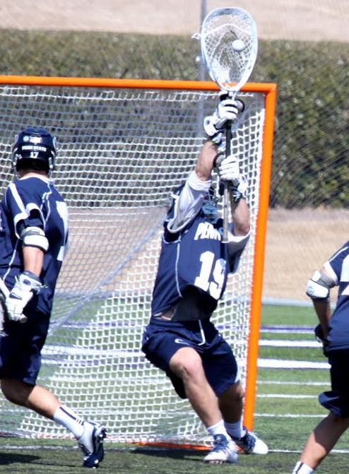 PSU sophomore Will Schreiner (Avon Grove) goes high to make a stop in Tuesday's win (Photo for Phillylacrosse.com)