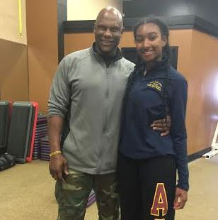 Dañiela Wright with trainer Carlos Bradley