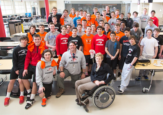 Katie Samson is seen here with Harriton High's boys' team in 2014