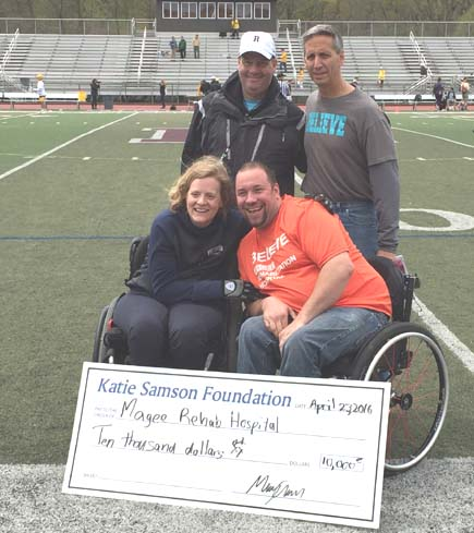 Katie Samson presents a check for $10,000