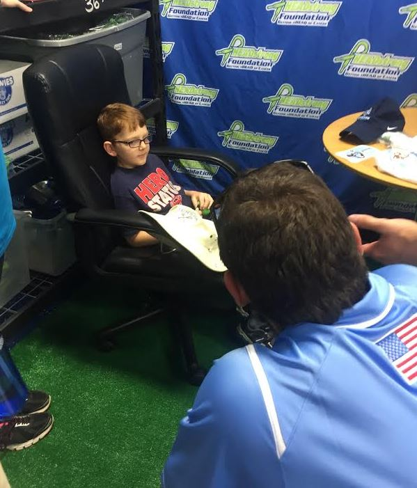 Tufts senior defenseman Jon Sax (St. Joseph's Prep, Lawrenceville School) speaks to 9-year-old Jacob at Nick's GHouse Friday