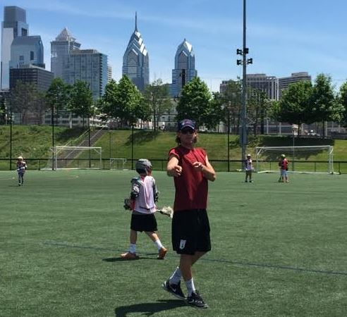 NXT's Brett Manney directs traffic with the Philly skyline in the background