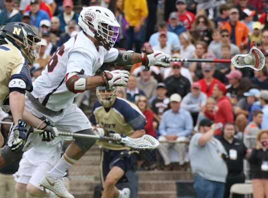 Will Gural wins a face-off vs Navy (Photos by Rene Schleicher)