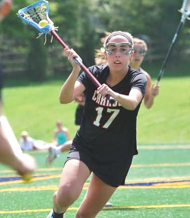 Archbishop Caroll's AnnaMurphy had five goals, including the game-winner, and six draw ctrols Satursay in the Patriots' 13-12 win (Photo coirtesy of Scott Grpwney)