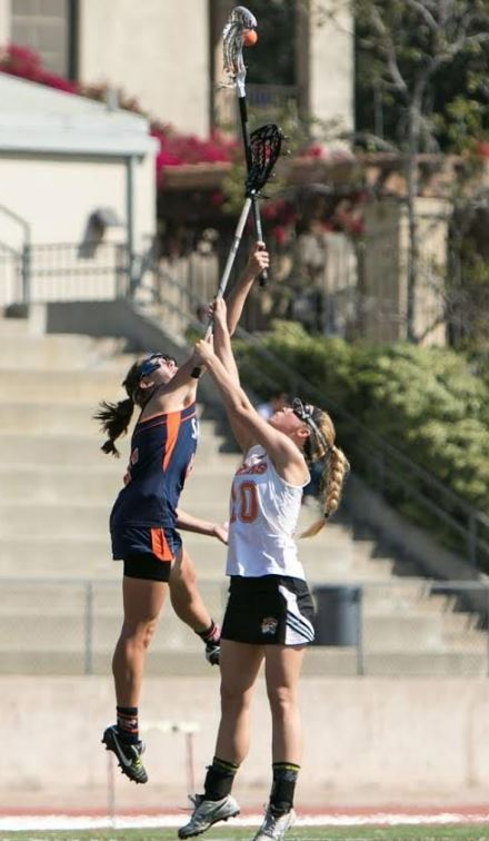 Pomona-Pitzer All-American Ally McLaughlin (left) skies for a draw control in action this year for the Sagehens, who reached the NCAA D3 Round of 16