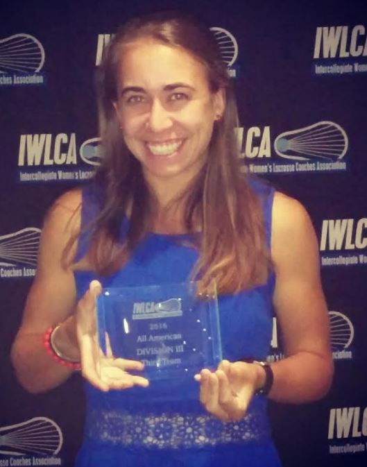 McLaughjlin accepts her All-America honor at a recent banquet in Valley Forge