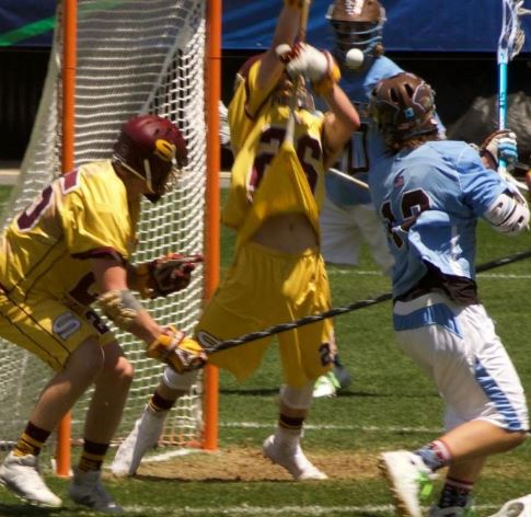 Kyle Tucker (Downingtown East grad, left) defends for Salisbury while MVP Colin Reymann makes the save (Photo by Alan Simpson)