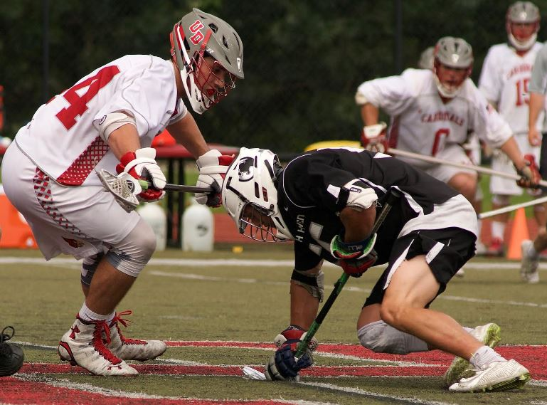 Strath Haven's Hunter Mazur fights for the ball vs. Jack Rapine at the face-off X