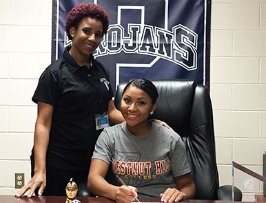Pottstown senior MarDaije Pearson, joined by Pottstown teacher Michaela Johnson, makes a verbal commitment to continue her academic and lacrosse career at Chestnut Hill College during a recent ceremony at the high school.