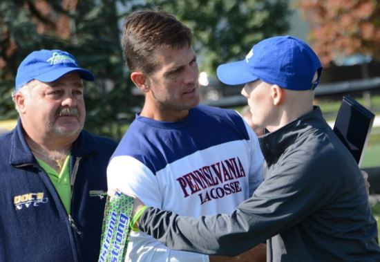 Penn coach Mike Murphy (middle) is joined by Pat Colleluori Sr. (left) and