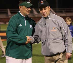 Princeton's Chris Bates (right) is congratulated by Manhattan head coach Steve Manitta after Princeton's 15-2 win Tuesday night. It was the 100th win of Bates' career, with 70 at Drexel and 30 at Princeton. (File Photo courtesy of Noel Valero)