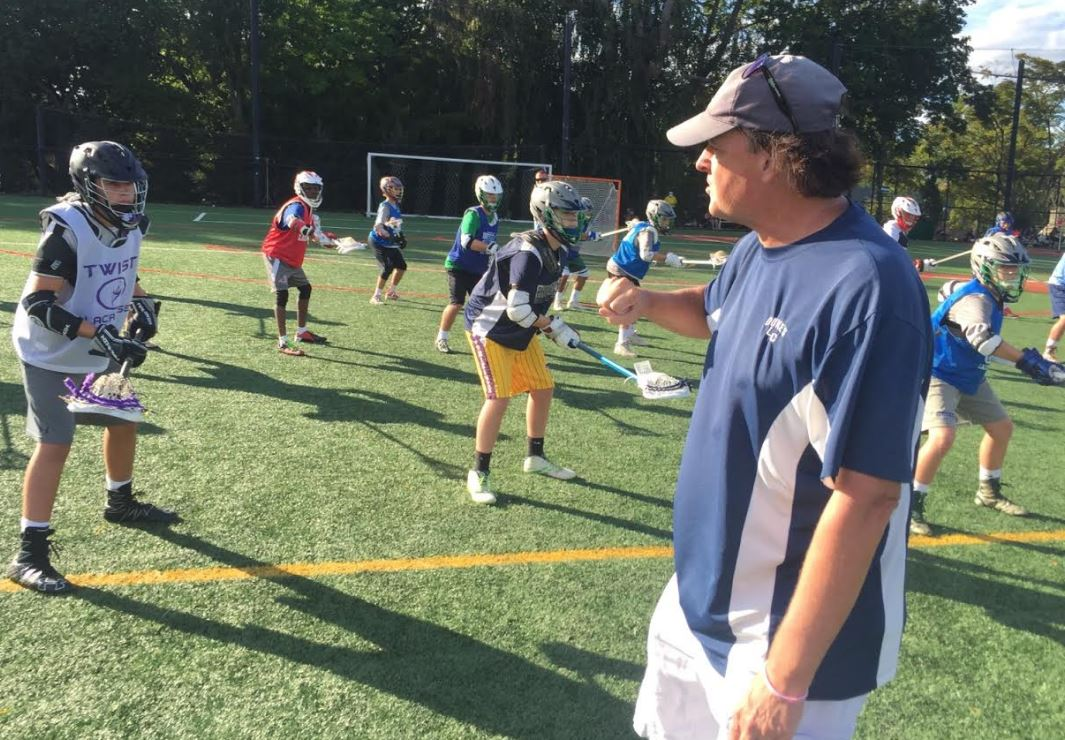 Dukes LC head coach Ebe Helm directs a defenseman csession in last week's Ricky Whelan Clinics at Shipley