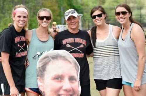 "Dee Cross (middle) is seen here with daughters (from left) Julie, Amy, me, Ali and Kelly after she ""retired"" in 2015 - the Cross sisters created the ""Fat Head"" photo to celebrate her career"