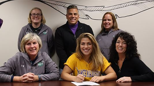 Daria Lucchesi signs a national letter of intent to accept a Division I lacrosse scholarship from James Madison University. Pictured from left (standing), Catie Sobotor (Methacton coach), William Lucchesi (father), Casey Leap (coach); seated from left Laurie Markle (head coach), Daria Lucchesi, Angela Lucchesi (mother)